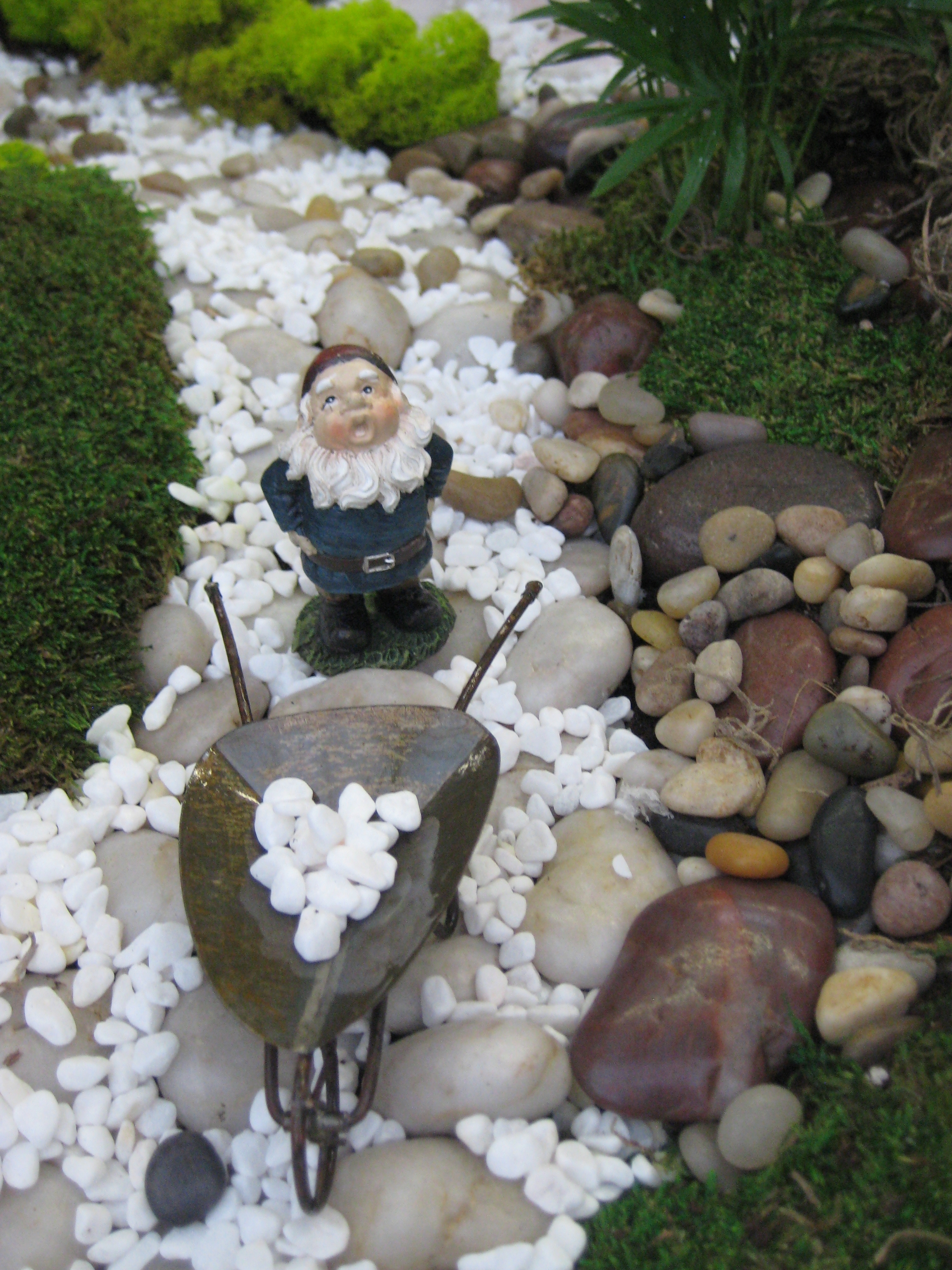 Image of: A Miniature Fairy Garden Designed In White Otten Bros Garden Intended For White Stones Landscaping Beautiful White Stones Landscaping