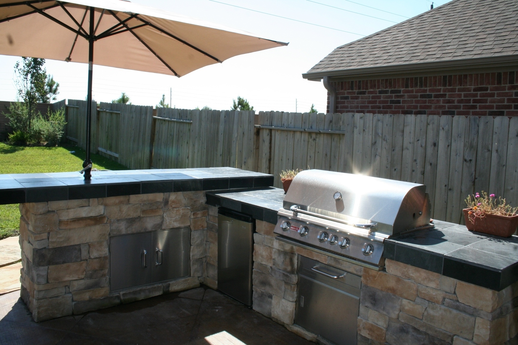 Image of: Homescapes Construction Outdoor Kitchens Pergolas Fire Pits In Fire Magic Outdoor Kitchen Grill Fire Magic Outdoor Kitchen