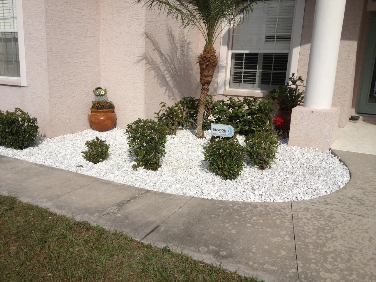 Image of: Landscaping Rock White Green Coast Sprinkler Lawn Care Our Work Throughout White Stones Landscaping Beautiful White Stones Landscaping