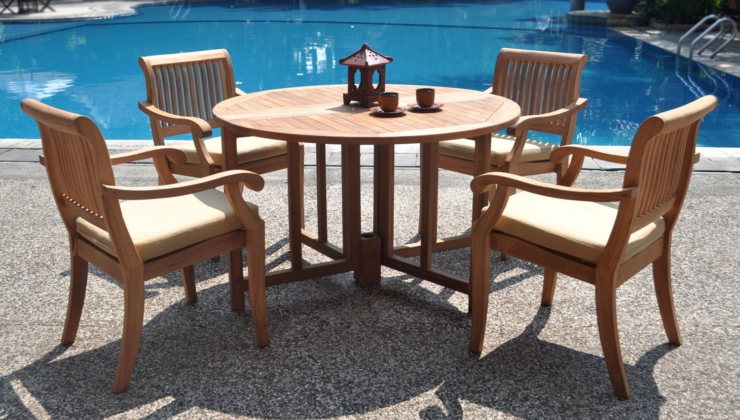 Image of: Modern Concept Teak Patio Table And Chairs Teak Patio Dining Set For Modern Teak Outdoor Furniture How To Care Modern Teak Outdoor Furniture