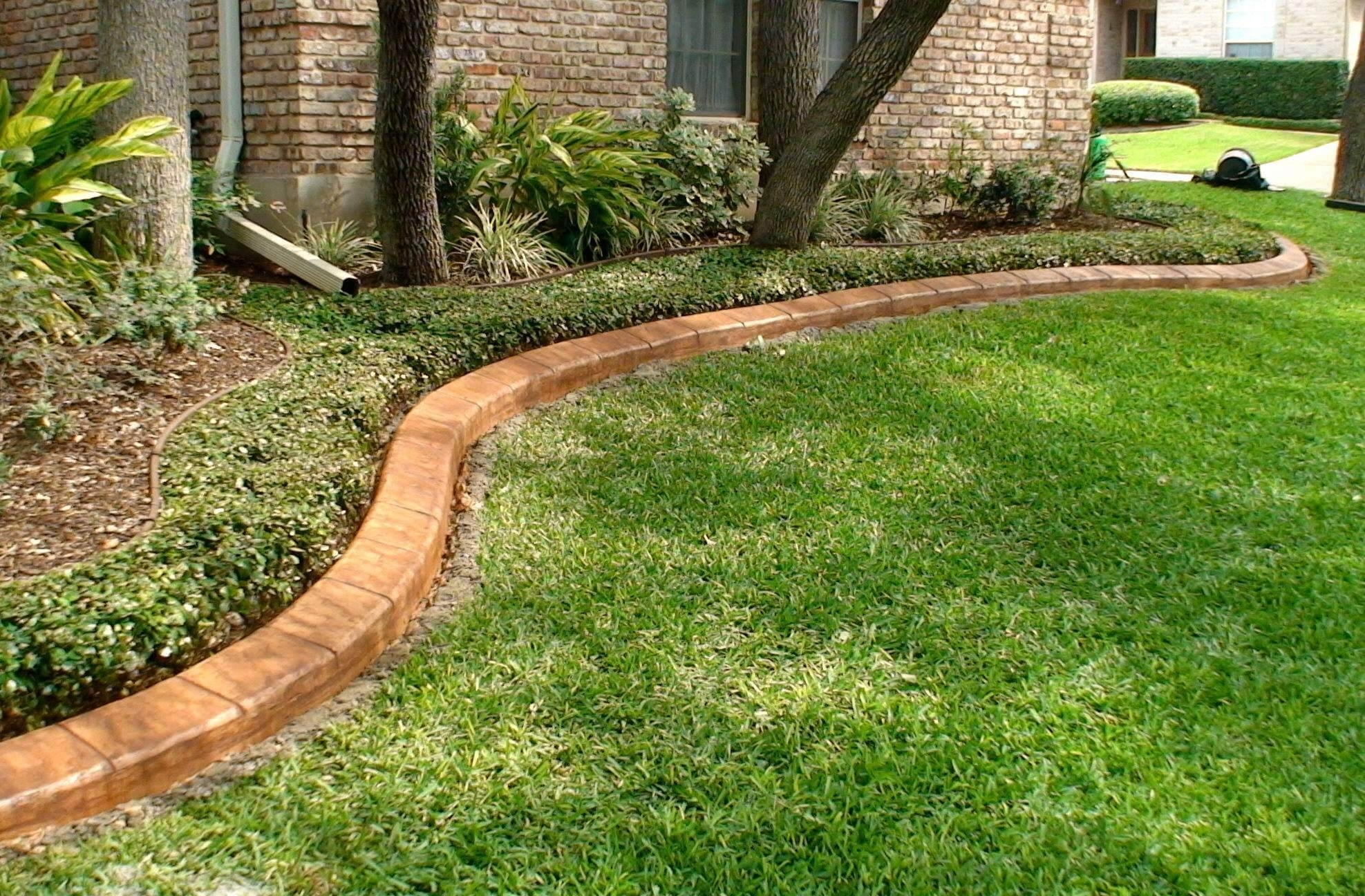 Image of: Decorative Concrete Curbing The Sodfather Titusville Fl With Regard To Landscape Concrete Edging Installation Landscape Concrete Edging Installation