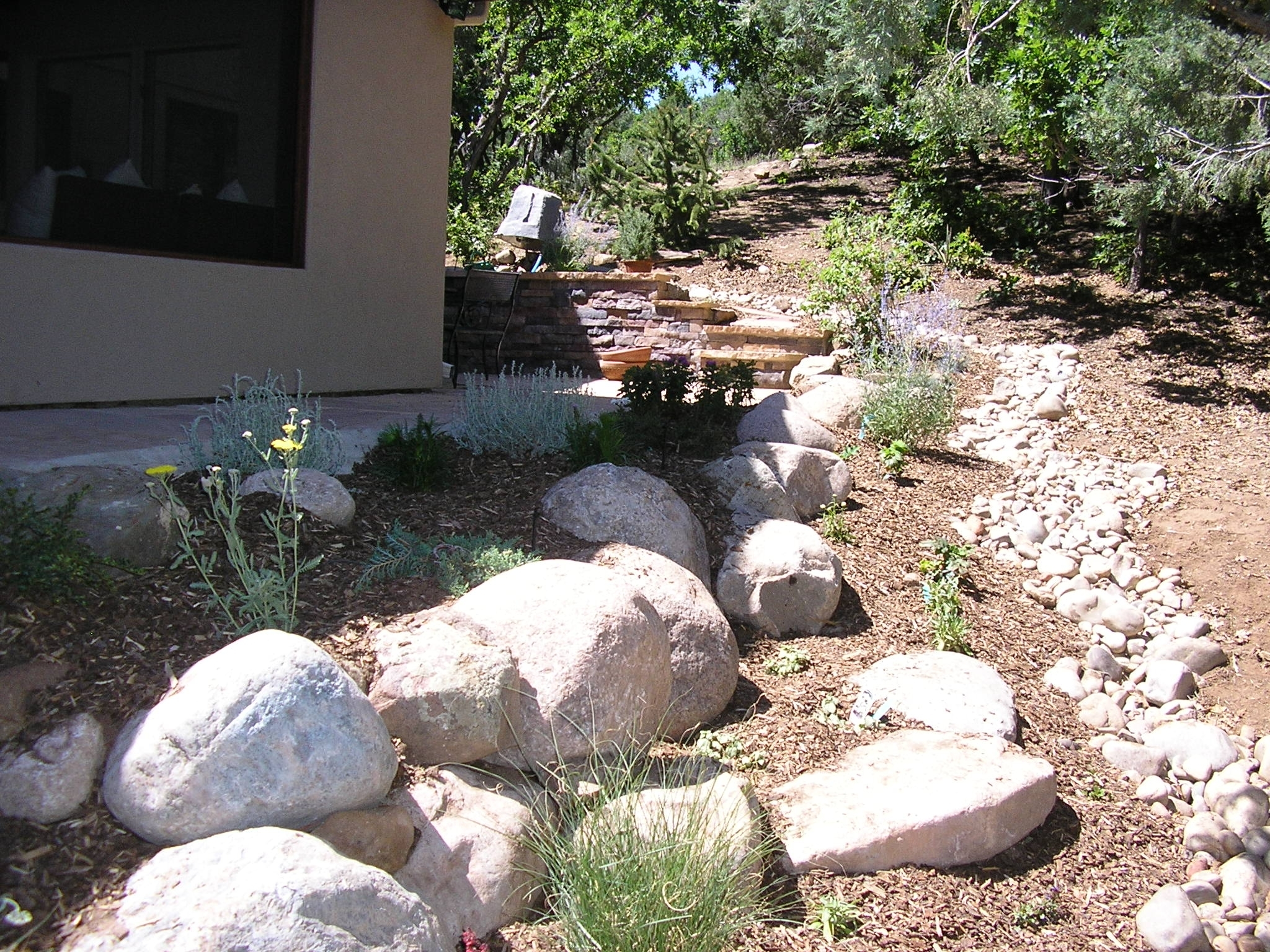 Image of: Drainage Swale Also Used Woodchips And Ground Cover To Be Within Drainage Ditch Landscaping Ideas Natural Drainage Ditch Landscaping Ideas