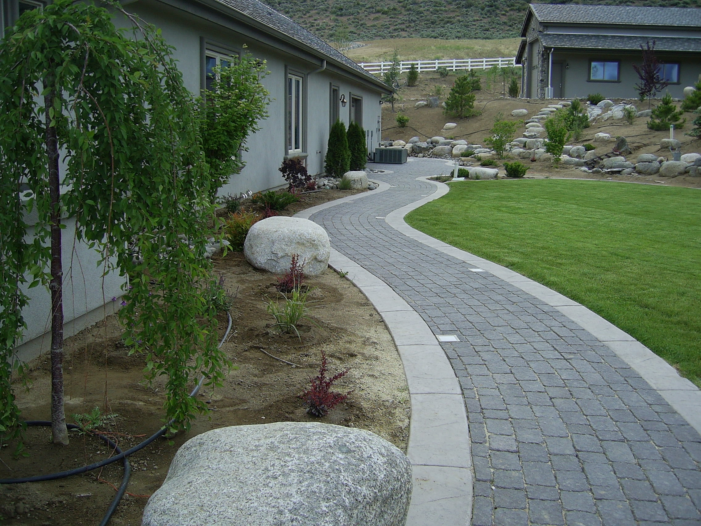 Image of: Edging Materials In Landscapes Steve Snedekers Landscaping And Throughout Landscape Concrete Edging Installation Landscape Concrete Edging Installation