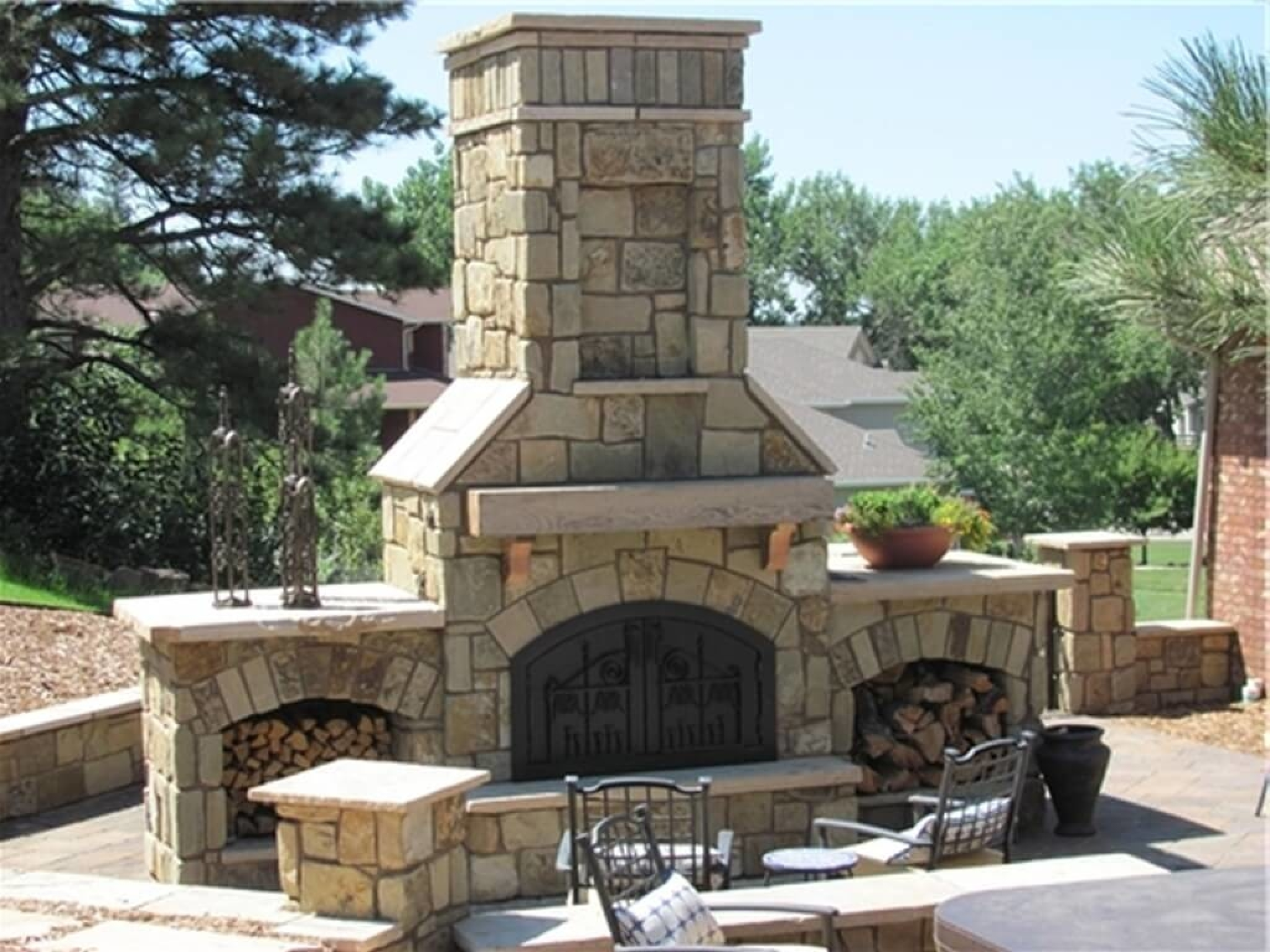 Image of: Exterior Design Elegant Double Side Outdoor And Indoor Wood Within Inside Outdoor Wood Fireplace Design Outdoor Wood Fireplace Designs