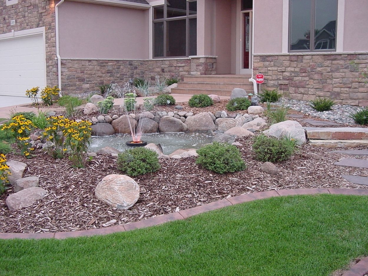 Image of: Front Yard Rock Landscaping With Fountain Rocky Yard Will Please In Front Yard Landscaping With Rocks Create Front Yard Landscaping With Rocks