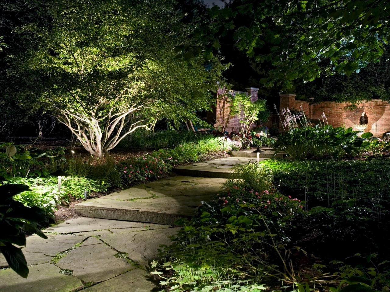 Image of: How To Illuminate Your Yard With Landscape Lighting Hgtv Throughout Landscape Uplights Landscape Uplights Year Round