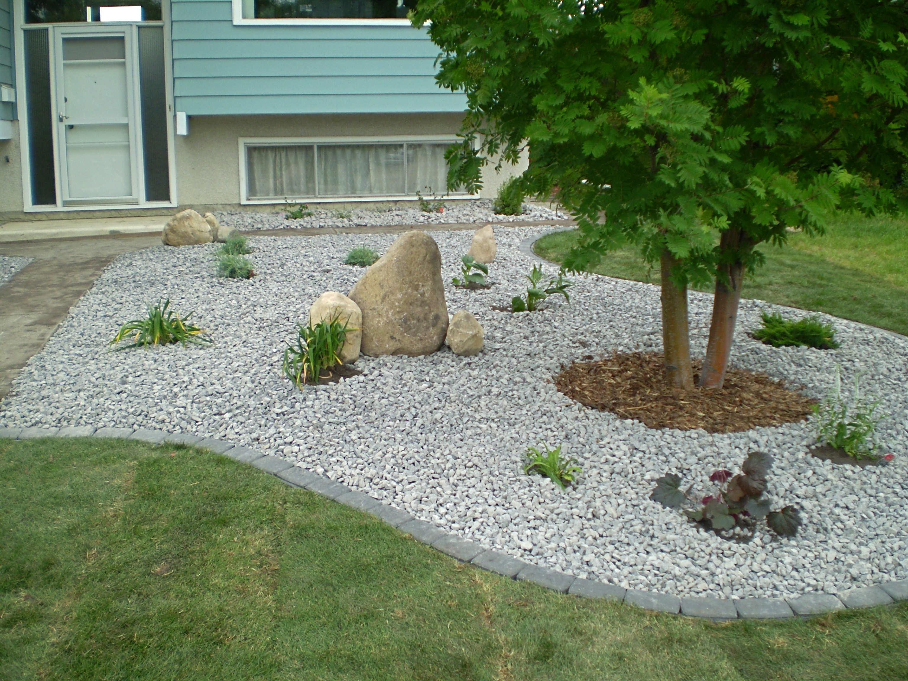 Image of: Landscaping With Rocks And Stones Whitemud Garden Centre And Throughout Front Yard Landscaping With Rocks Create Front Yard Landscaping With Rocks