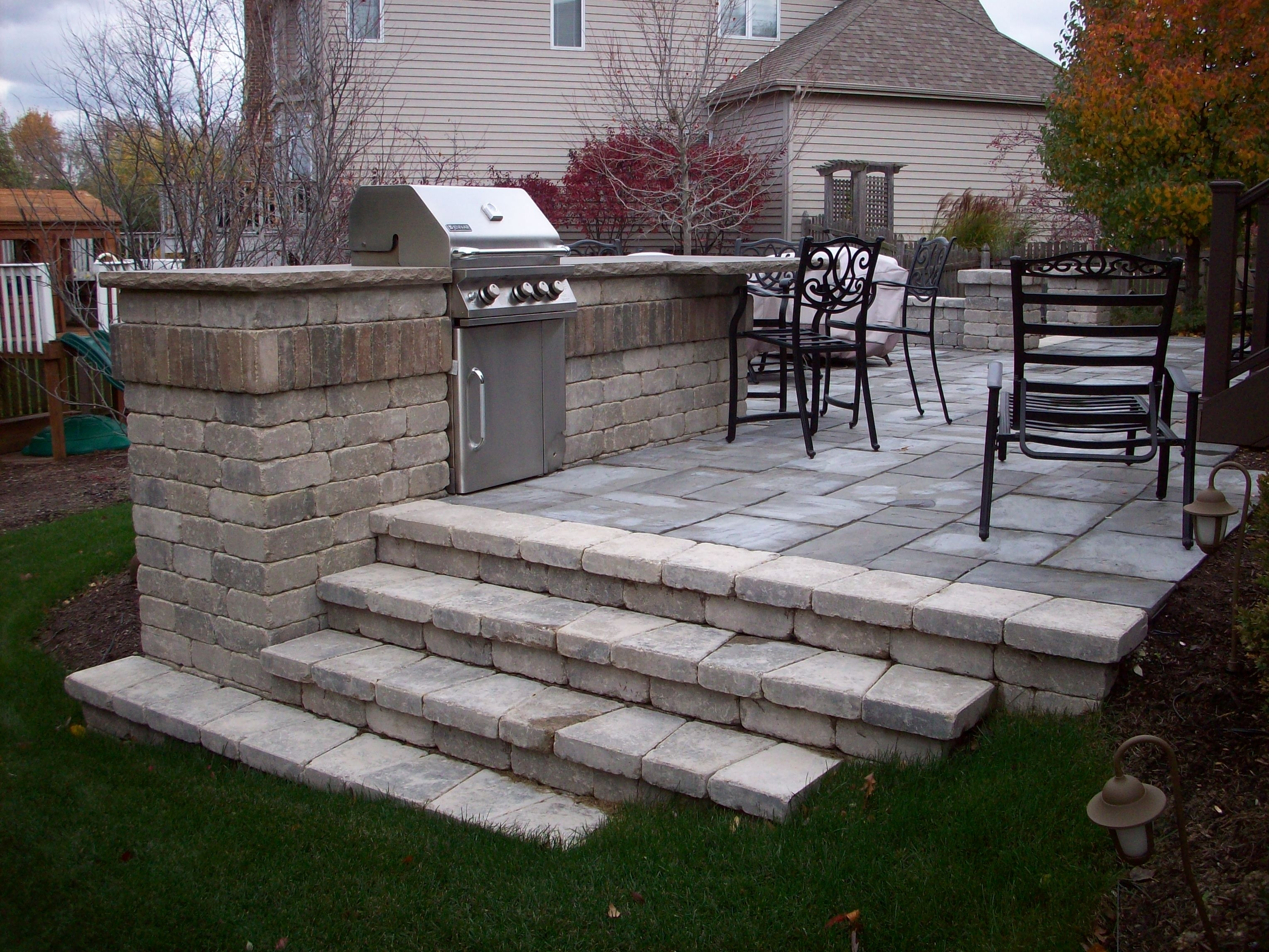 Image of: Outdoor Kitchens Unilock Olde Quarry Bbq And Steps Limestone Throughout Unilock Outdoor Kitchens Decorate Unilock Outdoor Kitchens