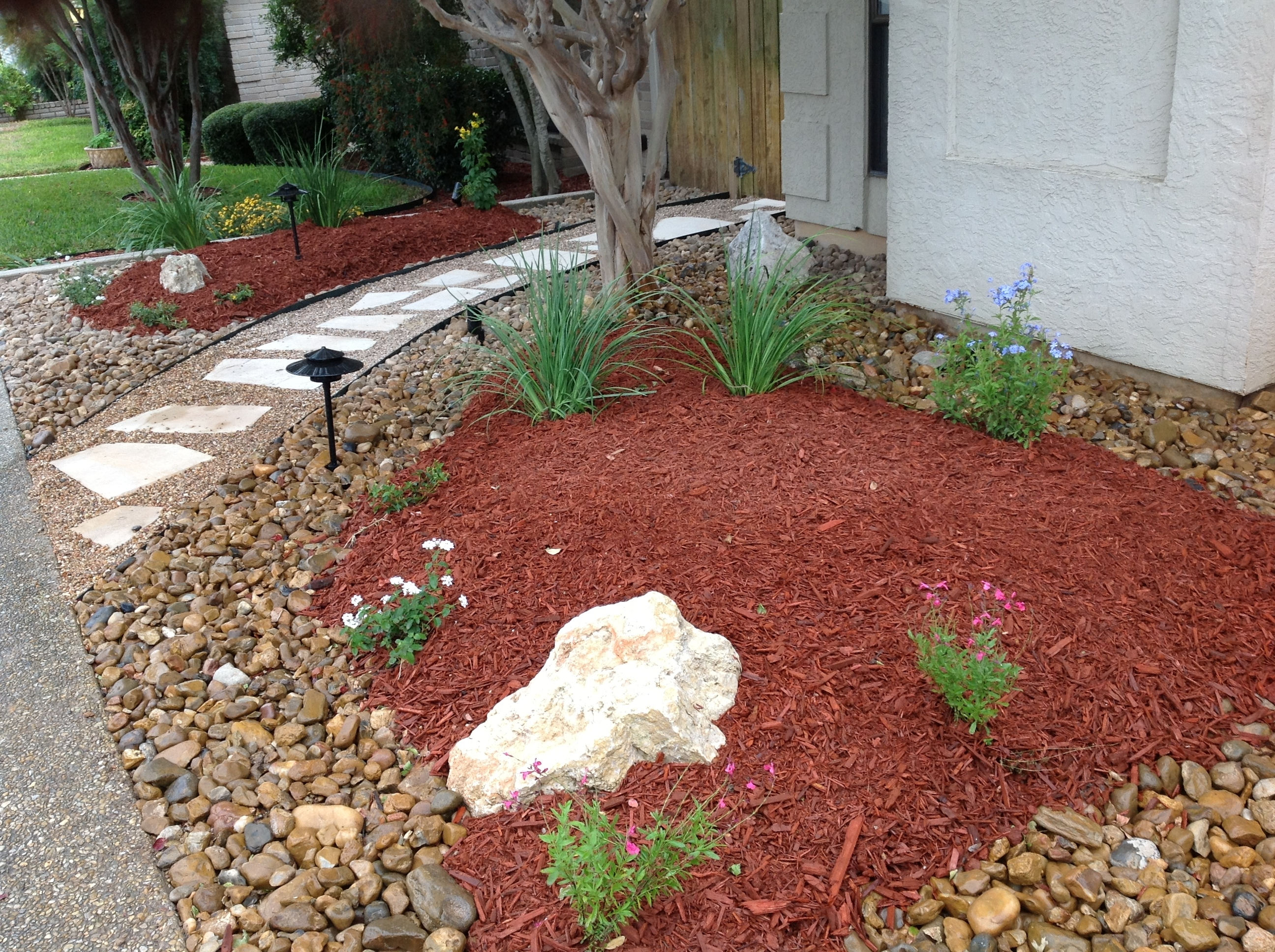 Image of: Rocks Against Paths Bark Mulch In Planting Area Stepping Stones In Landscaping Bark Landscaping Bark For Season