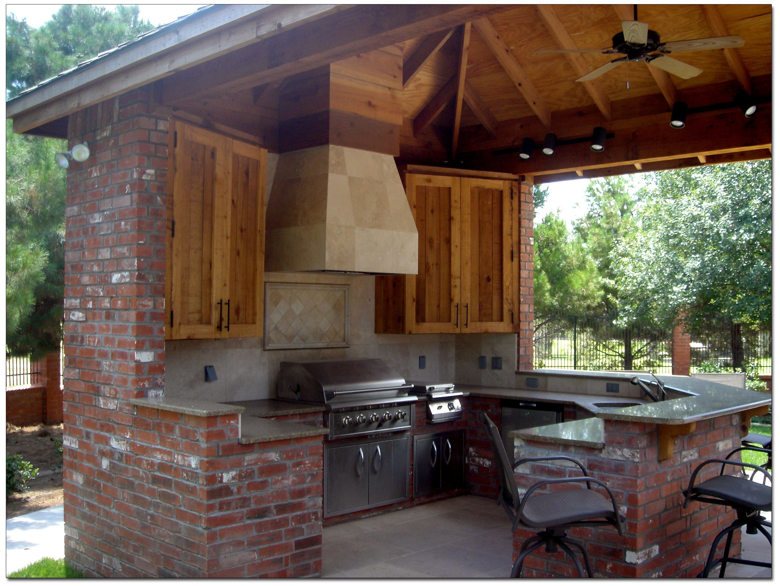 Image of: Single Sink Under Arched Crane On Countertops And Brick Wall For Pertaining To Outdoor Kitchen Wood Countertops Nice Outdoor Kitchen Wood Countertops Inspiration