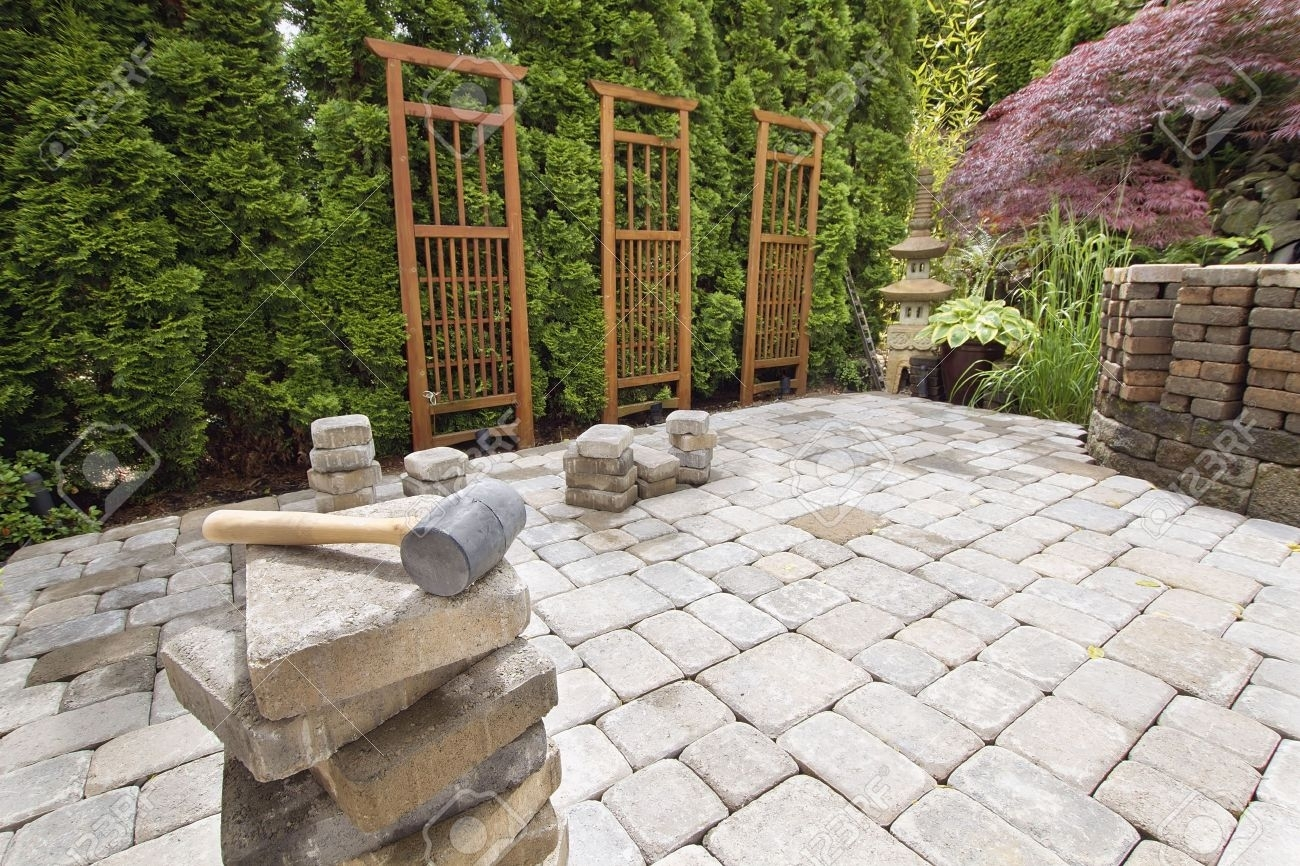 Image of: Stack Of Brick Pavers For Hardscape In Backyard Landscaping With Regarding Landscaping Pavers Easy Steps To Install Landscaping Pavers