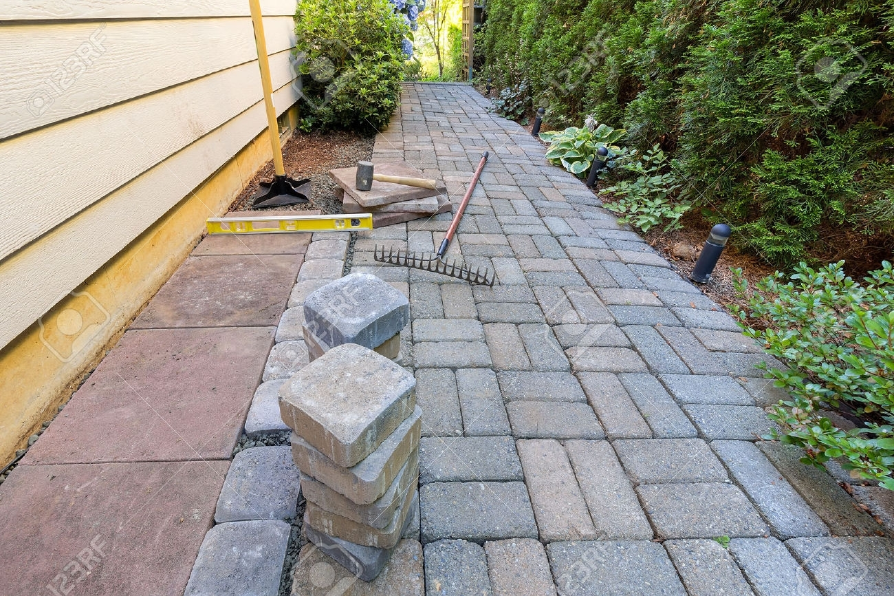 Image of: Stone Pavers And Tiles For Side Yard Patio Hardscape With Garden Intended For Landscaping Pavers Easy Steps To Install Landscaping Pavers
